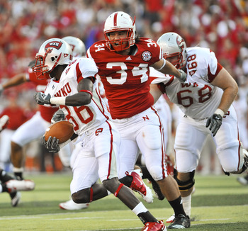 LINCOLN, NE - SEPTEMBER 04:  Will Adams #36 of the Western Kentucky Hilltoppers trys to avoid Cameron Meredith #34 of the Nebraska Cornhuskers during first half action of their game at Memorial Stadium on September 4, 2010 in Lincoln, Nebraska. Nebraska d