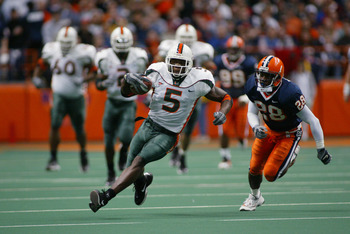 SYRACUSE, NY - NOVEMBER 30: Andre Johnson #5 of the University of Miami runs upfield as Keeon Walker #28 of Syracuse University tries to catch him during the game at the Carrier Dome on November 30, 2002 in Syracuse, New York.  Miami won 49-7.  (Photo by
