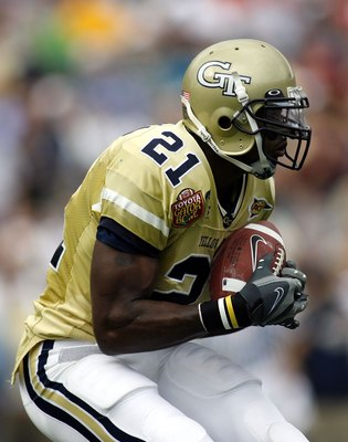 JACKSONVILLE, FL - JANUARY 01:  Wide rceiver Calvin Johnson #21 of the Georgia Tech Yellow Jackets makes a reception during a game against the West Virginia Mountaineers in the Toyota Gator Bowl at Alltel Stadium January 1, 2007 in Jacksonville, Florida.