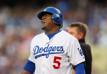 LOS ANGELES, CA - JULY 07:  Juan Uribe #5 of the Los Angeles Dodgers reacts after being hit by a pitch in the second inning during the MLB game against the New York Mets at Dodger Stadium on July 7, 2011 in Los Angeles, California.  (Photo by Victor Decol
