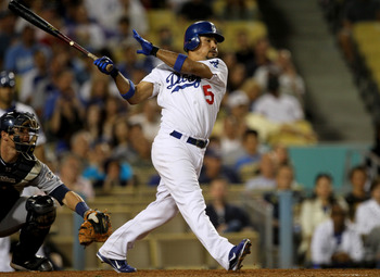 LOS ANGELES, CA - JULY 8:  Rafael Furcal #15 of the Los Angeles Dodgers hits an RBI single to give the Dodgers a 1-0 lead in the eighth inning against the San Diego Padres on July 8, 2011 at Dodger Stadium in Los Angeles, California.   (Photo by Stephen D