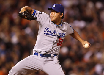 SAN FRANCISCO, CA - JULY 19:  Hong-Chih Kuo #56 of the Los Angeles Dodgers pitches against the San Francisco Giants at AT&T Park on July 19, 2011 in San Francisco, California.  (Photo by Jed Jacobsohn/Getty Images)