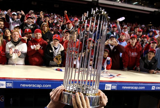 PHILADELPHIA - OCTOBER 29:  The World Series Championship trophy is held up in front of fans of the Philadelphia Phillies after they won 4-3 against the Tampa Bay Rays during the continuation of game five of the 2008 MLB World Series on October 29, 2008 a