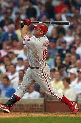 CHICAGO - JULY 30:  Jim Thome #25 of the Philadelphia Phillies makes a hit during the game against the Chicago Cubs  at Wrigley Field on July 30, 2004 in Chicago, Illinois. The Cubs defeated the Phillies 10-7. (Photo by Jonathan Daniel/Getty Images)