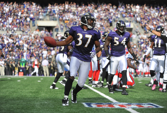BALTIMORE, MD - OCTOBER 24:  Josh Wilson #37 of the Baltimore Ravens celebrates a fumble recovery against the Buffalo Bills at M&T Bank Stadium on October 24, 2010 in Baltimore, Maryland. The Ravens defeated the Bills 37-34. (Photo by Larry French/Getty I