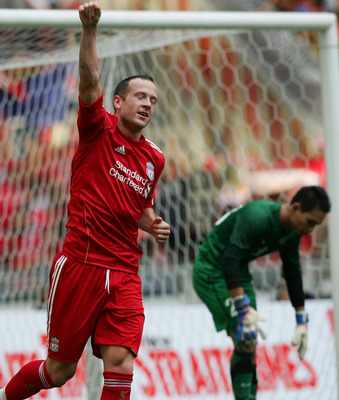 KUALA LUMPUR, MALAYSIA - JULY 16: Charlie Adam of Liverpool celebrates after scoring from the penalty spot during the pre-season friendly match between Malaysia and Liverpool at the Bukit Jalil National Stadium on July 16, 2011 in Kuala Lumpur, Malaysia.