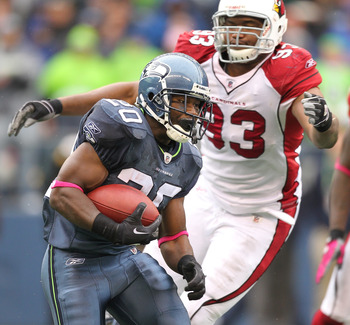 SEATTLE - OCTOBER 24:  Running back Justin Forsett #20 of the Seattle Seahawks rushes against Calais Campbell #93 the Arizona Cardinals at Qwest Field on October 24, 2010 in Seattle, Washington. The Seahawks defeated the Cardinals 22-10. (Photo by Otto Gr