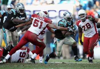 CHARLOTTE, NC - DECEMBER 19:  Jonathan Stewart #28 of the Carolina Panthers runs away from Paris Lenon #51 of the Arizona Cardinals during their game at Bank of America Stadium on December 19, 2010 in Charlotte, North Carolina.  (Photo by Streeter Lecka/G