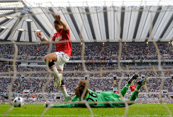 NEWCASTLE, UNITED KINGDOM - APRIL 19:  Tim Krul of Newcastle United dives to make a save at the feet of Javier Hernandez of Manchester United during the Barclays Premier League match between Newcastle United and Manchester United at St James' Park on Apri