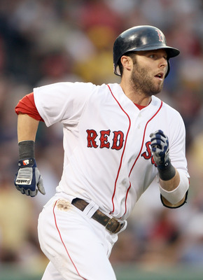 BOSTON, MA - JULY 05:  Dustin Pedroia #15 of the Boston Red Sox rounds first base after his solo home run in the third inning against the Toronto Blue Jays  on July 5, 2011 at Fenway Park in Boston, Massachusetts.  (Photo by Elsa/Getty Images)