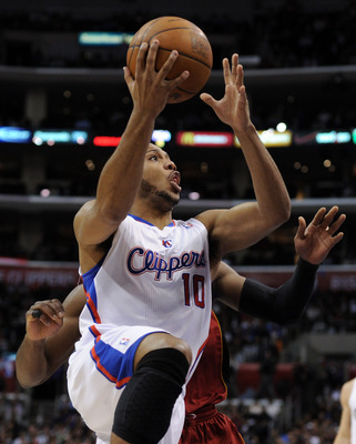 LOS ANGELES, CA - JANUARY 12:  Eric Gordon #10 of the Los Angeles Clippers scores on a layup against the Miami Heat at Staples Center on January 12, 2011 in Los Angeles, California.  NOTE TO USER: User expressly acknowledges and agrees that, by downloadin