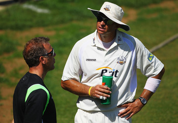 NORTHAMPTON, ENGLAND - MAY 24:  Alec Stewart, Coach of Surrey talks to Andre Nel during the LV County Championship match between Northamptonshire and Surrey at the County Ground on May 24, 2010 in Northampton, England.  (Photo by Matthew Lewis/Getty Image