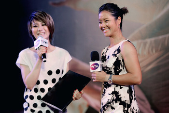 BEIJING, CHINA - JULY 05:  French Open champion Li Na (R) with Guest singer during in celebration event with her fans organized by Women Tennis Association (WTA) on July 5, 2011 in Beijing, China.  (Photo by Lintao Zhang/Getty Images)