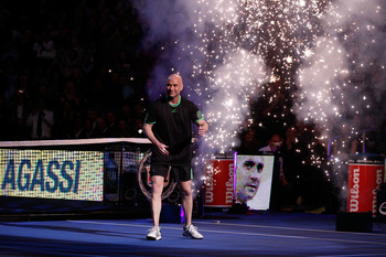 NEW YORK, NY - FEBRUARY 28:  Andre Agassi walks onto the court as he is introduced prior to his match against Pete Sampras during the BNP Paribas Showdown at Madison Square Garden on February 28, 2011 in New York City.  (Photo by Mike Stobe/Getty Images f
