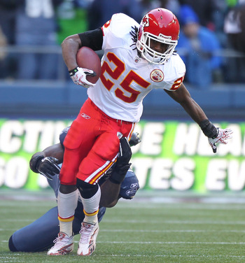 SEATTLE, WA - NOVEMBER 28:  Running back Jamaal Charles #25 of the Kansas City Chiefs rushes against Aaron Curry #59 of the Seattle Seahawks at Qwest Field on November 28, 2010 in Seattle, Washington. (Photo by Otto Greule Jr/Getty Images)