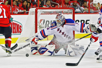 WASHINGTON , DC - APRIL 23:  Henrik Lundqvist #30 of the New York Rangers stops a shot on goal by a member of the Washington Capitals in Game Five of the Eastern Conference Quarterfinals during the 2011 NHL Stanley Cup Playoffs at the Verizon Center on Ap