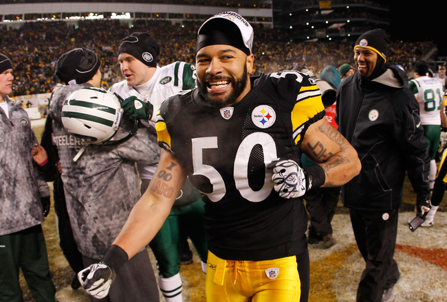 PITTSBURGH, PA - JANUARY 23:  Larry Foote #50 of the Pittsburgh Steelers celebrates after they defeated the New York Jets 24 to 19 in the 2011 AFC Championship game at Heinz Field on January 23, 2011 in Pittsburgh, Pennsylvania.  (Photo by Gregory Shamus/