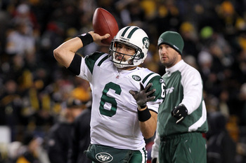 PITTSBURGH, PA - JANUARY 23:  Mark Sanchez #6 of the New York Jets warms up in front of offensive coordinator Brian Schottenheimer against the Pittsburgh Steelers during the 2011 AFC Championship game at Heinz Field on January 23, 2011 in Pittsburgh, Penn