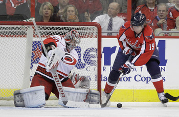 WASHINGTON, DC - MARCH 29: Goalie Cam Ward #30 of the Carolina Hurricanes makes a save against Nicklas Backstrom #19 of the Washington Capitals during the second period at the Verizon Center on March 29, 2011 in Washington, DC.  (Photo by Rob Carr/Getty I