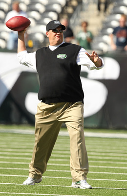 EAST RUTHERFORD, NJ - SEPTEMBER 19:  Rex Ryan, Head Coach of the New York Jets throws passes before the game against the New England Patriots on September 19, 2010 at the New Meadowlands Stadium  in East Rutherford, New Jersey.  (Photo by Al Bello/Getty I
