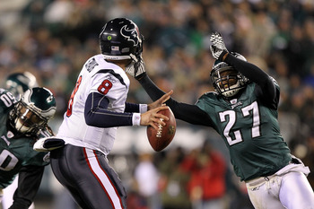 PHILADELPHIA, PA - DECEMBER 02:  Quintin Mikell #27 of the Philadelphia Eagles applies pressure on a blitz against quarterback Matt Schaub #8 of the Houston Texans at Lincoln Financial Field on December 2, 2010 in Philadelphia, Pennsylvania.  (Photo by Al