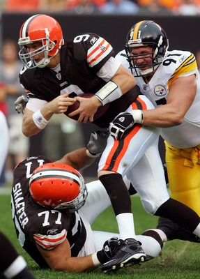 CLEVELAND - SEPTEMBER 9:   Charlie Frye #9 of the Cleveland Browns is sacked by Aaron Smith #91 of the Pittsburgh Steelers during their season opening game at Cleveland Browns Stadium September 9, 2007 in Cleveland, Ohio.  (Photo by Jim McIsaac/Getty Imag
