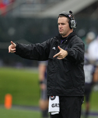 EVANSTON, IL - OCTOBER 23: Head coach Pat Fitzgerald of the Northwestern Wildcats signals his teamas they take on the Michigan State Spartans at Ryan Field on October 23, 2010 in Evanston, Illinois. Michigan State defeated Northwestern 35-27.  (Photo by J