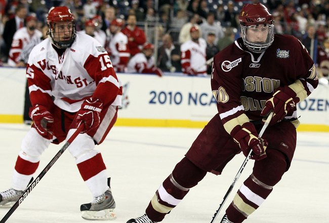 DETROIT - APRIL 10:   Jimmy Hayes #10 of the Boston College Eagles takes the puck as Craig Smith #15 of the Wisconsin Badgers defends during the championship game of the 2010 NCAA Frozen Four on April 10, 2010 at Ford Field in Detroit, Michigan. Boston Co