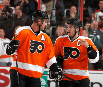 PHILADELPHIA, PA - FEBRUARY 03:  Jeff Carter #17 and Mike Richards #18 of the Philadelphia Flyers talk during a break in action in an NHL hockey game against the Nashville Predators at the Wells Fargo Center on February 3, 2011 in Philadelphia, Pennsylvan