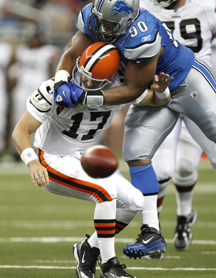 DETROIT - AUGUST 28:  Ndamukong Suh #90 of the Detroit Lions tackles Jake Delhomme #17 of the Cleveland Browns during a preseason game on August 28, 2010 at Ford Field in Detroit, Michigan. Suh was called for a personal foul on the play for grabbing the f