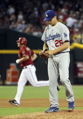 PHOENIX, AZ - JULY 17:  Starting pitcher Ted Lilly #29 of the Los Angeles Dodgers reacts after giving up a solo home run to Daniel Hudson #41 of the Arizona Diamondbacks during the sixth inning of the Major League Baseball game at Chase Field on July 17,