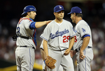 PHOENIX, AZ - JULY 17:  Starting pitcher Ted Lilly #29 of the Los Angeles Dodgers is taken out by manager Don Mattingly during the seventh inning of the Major League Baseball game against the Arizona Diamondbacks at Chase Field on July 17, 2011 in Phoenix