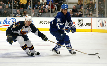 TORONTO - FEBRUARY 23:  Bobby Holik #16 of the Atlanta Thrashers tries to block a pass by Pavel Kubina #31 of the Toronto Maple Leafs during their NHL game at the Air Canada Centre on February 23, 2008 in Toronto, Ontario.(Photo By Dave Sandford/Getty Ima