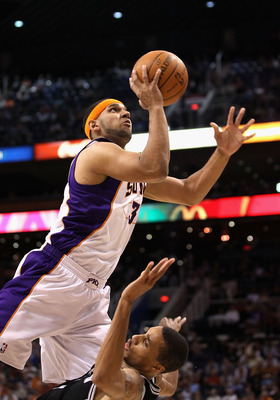 PHOENIX, AZ - APRIL 13:  Jared Dudley #3 of the Phoenix Suns puts up a shot against the San Antonio Spurs during the NBA game at US Airways Center on April 13, 2011 in Phoenix, Arizona.  NOTE TO USER: User expressly acknowledges and agrees that, by downlo
