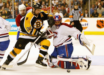 BOSTON - APRIL 19:  Goalie Jose Theodore #60 of the Montreal Canadiens makes a save on a shot taken by Martin Lapointe #20 of the Boston Bruins in game seven of the Eastern Conference Quarterfinals on April 19, 2004 at the Fleet Center in Boston, Massachu