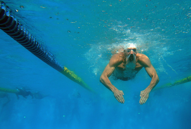SANTA CLARA, CA - JUNE 19:  Michael Phelps warms up in the practice pool during day 4 of the Santa Clara International Grand Prix at George F. Haines International Swim Center on June 19, 2011 in Santa Clara, California.  (Photo by Ezra Shaw/Getty Images)
