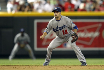 PHOENIX, AZ - JULY 17:  Infielder Jamey Carroll #14 of the Los Angeles Dodgers in action during the Major League Baseball game against the Arizona Diamondbacks at Chase Field on July 17, 2011 in Phoenix, Arizona. The Diamondbacks defeated the Dodgers 4-1.