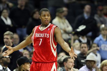 CHARLOTTE, NC - JANUARY 12:  Kyle Lowry #7 of the Houston Rockets reacts to a call against the Charlotte Bobcats at Time Warner Cable Arena on January 12, 2010 in Charlotte, North Carolina.  NOTE TO USER: User expressly acknowledges and agrees that, by do
