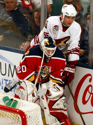SUNRISE, FL - FEBRUARY 10:  Goaltender Eddie Belfour #20 of the Florida Panthers collides with Ed Jovanovski #55 of the Phoenix Coyotes in the first period at the BankAtlantic Center on February 10, 2007 in Sunrise, Florida. (Photo by Eliot J. Schechter/G