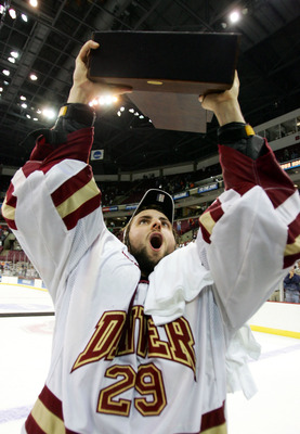 COLUMBUS, OH - APRIL 9:  Goalie Peter Mannino #29 of the Denver Pioneers raises the championship trophy after their victory over the North Dakota Fighting Sioux in the NCAA Frozen Four Championship game on April 9, 2005 at Value City Arena in Columbus, Oh