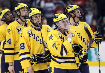 ST. PAUL, MN - APRIL 09:  Chad Langlais #7 of the Michigan Wolverines waits to shake hands with the Minnesota Duluth Bulldogs after the championship game of the 2011 NCAA Men's Frozen Four on April 9, 2011 at the Xcel Energy Center in St. Paul, Minnesota.