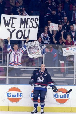 25 Nov 1997: A fan of center Mark Messier of the Vancouver Canucks holds a sign during a game against the New York Rangers at Madison Square Garden in New York City, New York.