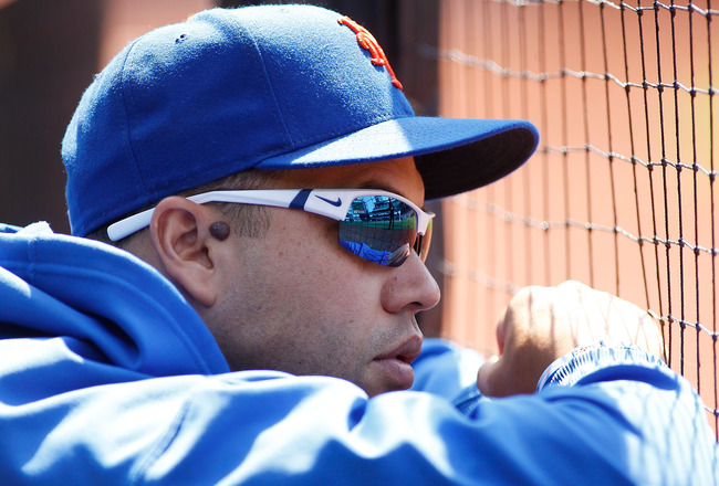 NEW YORK, NY - JULY 17:  Carlos Beltran #15 of the New York Mets looks on from the bench during the game against the Philadelphia Phillies on July 17, 2011 at Citi Field in the Flushing neighborhood of the Queens borough of New York City.  (Photo by Mike