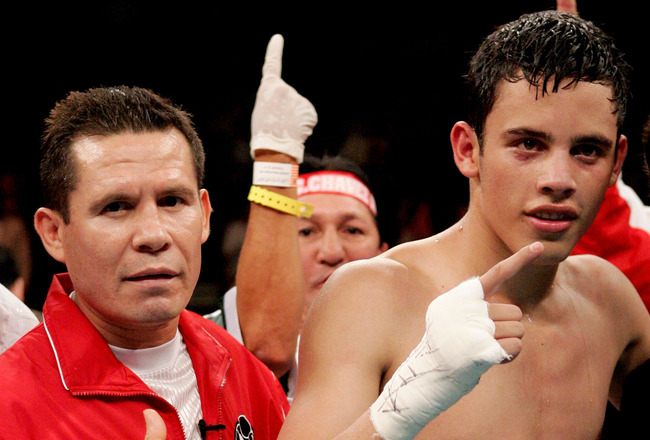 ATLANTIC CITY, NJ - JUNE 25:  Julio Cesar Chavez Jr. poses with his father, former boxer Julio Cesar Chavez, after Chavez Jr. defeated Ruban Galvan in the Junior Welterweight fight at Boardwalk Hall on June 25, 2005 in Atlantic City, New Jersey. Julio Ces