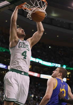 BOSTON, MA - MARCH 04:  Nenad Krstic #4 of the Boston Celtics dunks over David Lee #10 of the Golden State Warriors on March 4, 2011 at the TD Garden in Boston, Massachusetts.  NOTE TO USER: User expressly acknowledges and agrees that, by downloading and/