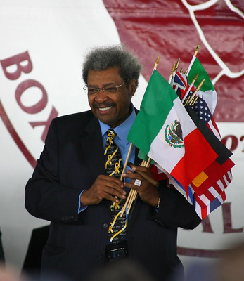 CANASTOTA, NY - JUNE 12: Don King holds flags during the 2011 International Boxing Hall of Fame Inductions at the International Boxing Hall of Fame on June 12, 2011 in Canastota, New York.  (Photo by Rick Stewart/Getty Images)