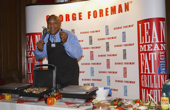 LONDON - DECEMBER 17:  Former World Heavyweight Champion George Foreman launches new additions to his Lean Mean range, at No 5, Cavendish Square on December 17, 2003 in London. New additions include the Lean Mean Toasting Machine and the Lean Mean Boiling