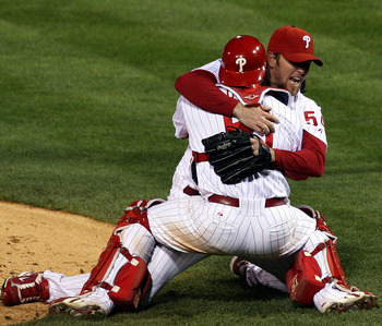 PHILADELPHIA - OCTOBER 29:  Brad Lidge #54 (facing camera) and Carlos Ruiz #51 of the Philadelphia Phillies hug as Ryan Howard runs towards them to celebrate  their 4-3 win to win the World Series against the Tampa Bay Rays during the continuation of game