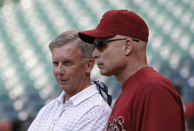 HOUSTON - APRIL 12:  General manager Ed Wade, left, of the Houston Astros and manager Brad Mills talk during batting practice before playing the Chicago Cubs at Minute Maid Park on April 12, 2011 in Houston, Texas. Mills has been suspended for one game an