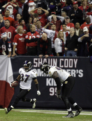 HOUSTON, TX - DECEMBER 13:  Cornerback Josh Wilson #37 of the Baltimore Ravens celebrates intercepting a pass from Matt Schaub of the Houston Texans in overtime at Reliant Stadium on December 13, 2010 in Houston, Texas.  (Photo by Bob Levey/Getty Images)